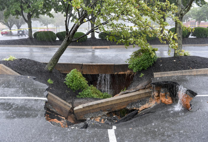 A sinkhole formed in the Berkshire Square Shopping Center parking lot in Wyomissing, Penn., on Wednesday afternoon.