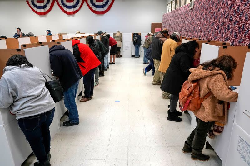 Voters stand at voting booths during early voting at the Oklahoma Election Board in Oklahoma City