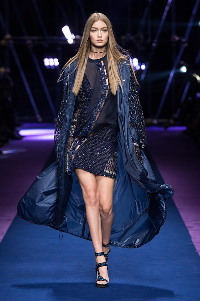 <p>Donatella's new favourite model took to the Versace runway in Milan. <i>[Photo: Versace]</i></p>