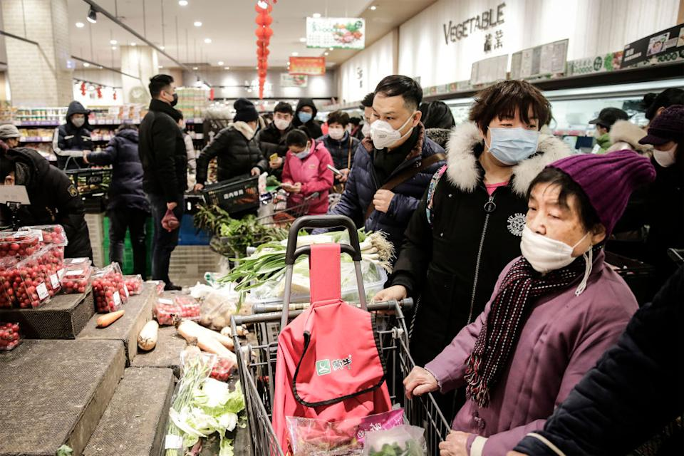Wuhan residents in January last year preparing for a city-wide lockdown. Source: Getty