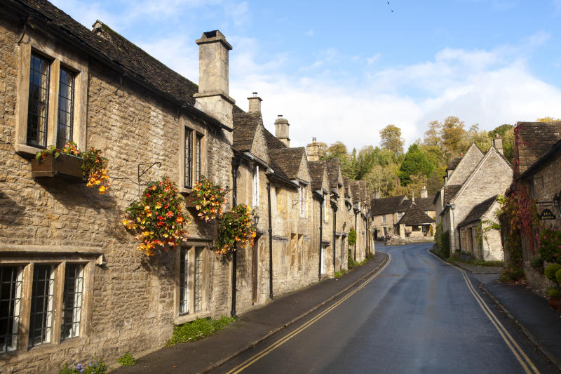 A row of attractive stone cottages in Castle Combe, Wiltshire, England, UK claimed to be Englands prettiest village. (Photo By: Geography Photos/Universal Images Group via Getty Images)