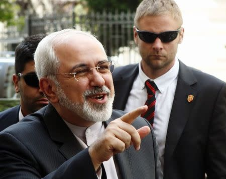 Iranian Foreign Minister Mohammad Javad Zarif talks to journalists as he arrives at his embassy in Vienna June 16, 2014. REUTERS/Heinz-Peter Bader