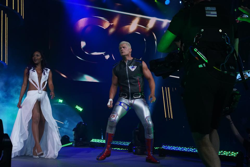 "Cody and Brandi Rhodes make their entrance during AEW ""Dynamite."" (Photo credit: All Elite Wrestling)"
