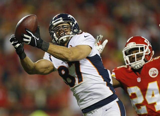 Denver Broncos wide receiver Eric Decker (87) makes a touchdown reception against Kansas City Chiefs cornerback Brandon Flowers (24) during the second half of an NFL football game, Sunday, Dec. 1, 2013, in Kansas City, Mo. (AP Photo/Ed Zurga)