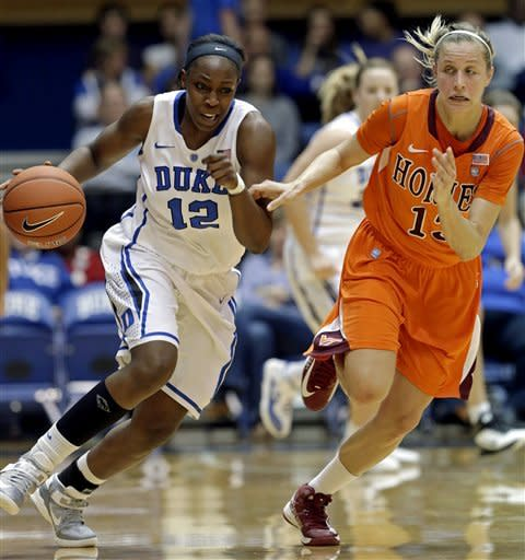 Duke's Chelsea Gray (12) is chased by Virginia Tech's Alyssa Fenyn during the first half of an NCAA college basketball game in Durham, N.C., Wednesday, Jan. 16, 2013. (AP Photo/Gerry Broome)