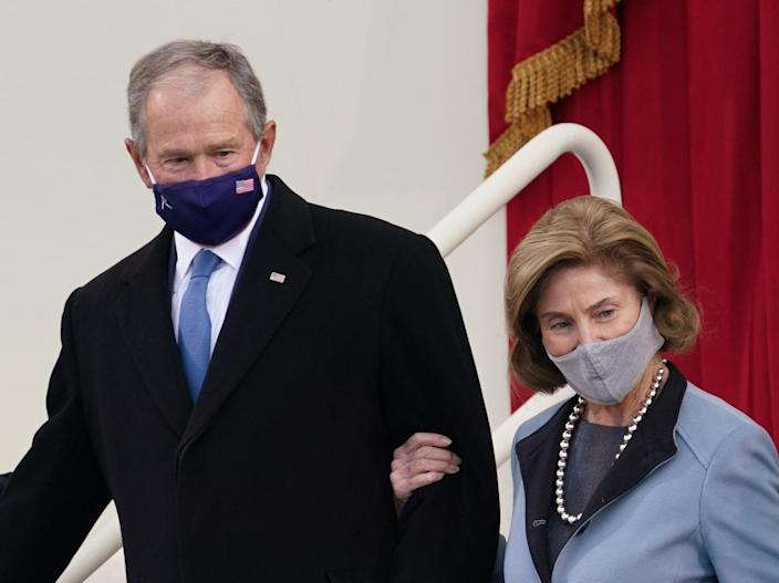 <p>Former US President George W Bush and his wife Laura Bush arrive for the inauguration of Joe Biden as the 46th President of the United States on the West Front of the U.S. Capitol in Washington, US, 20 January, 2021</p> (REUTERS)