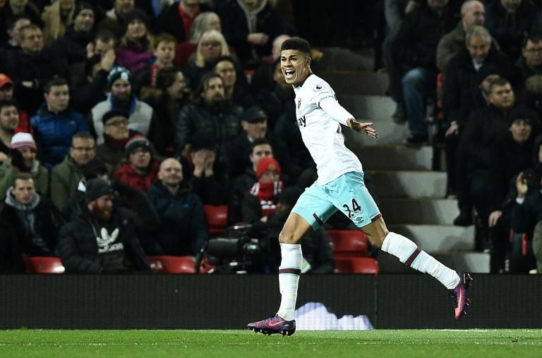 West Ham United's striker Ashley Fletcher celebrates scoring his team's first goal during the EFL Cup quarter-final football match between Manchester United and West Ham United on November 30, 2016