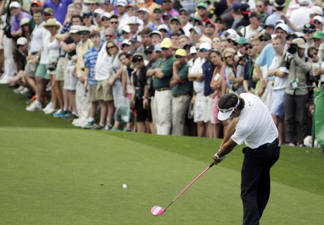 Bubba Watson tees off on the third hole during the fourth round of the Masters golf tournament Sunday, April 13, 2014, in Augusta, Ga. (AP Photo/Chris Carlson)
