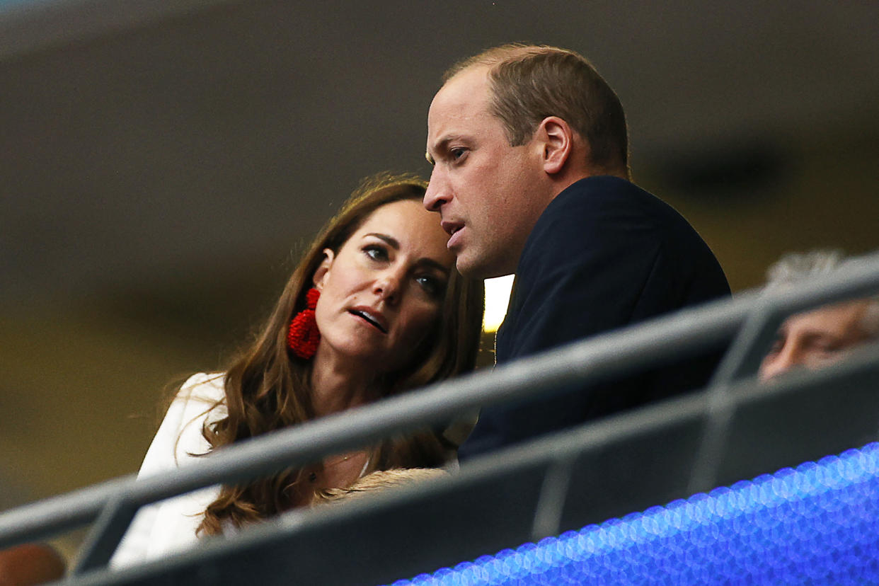 Prince William (R), Duke of Cambridge, listens to Catherine, Duchess of Cambridge, ahead of the UEFA EURO 2020 final football match between Italy and England at the Wembley Stadium in London on July 11, 2021. (Photo by JOHN SIBLEY / POOL / AFP) (Photo by JOHN SIBLEY/POOL/AFP via Getty Images)