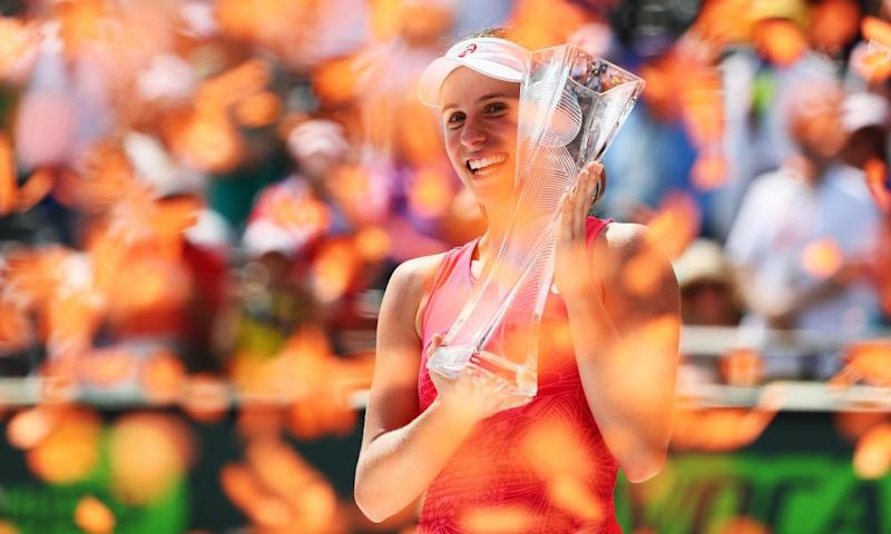 Johanna Konta holds the Butch Buchholz trophy after defeating Caroline Wozniacki in the Miami Open.