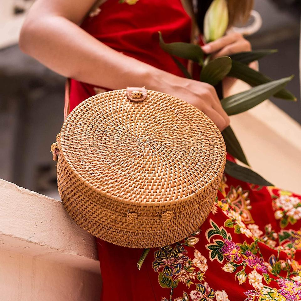 <p>Elevate her spring and summer look with this <span>Natural Neo Handwoven Round Rattan Shoulder Bag with Leather Straps</span> ($32).</p>