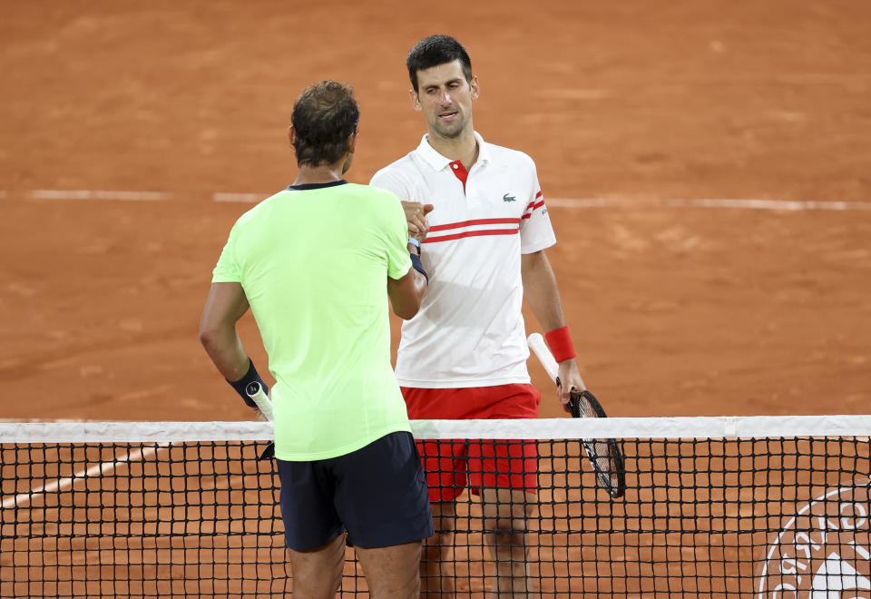 PARIS, FRANCE - JUNE 11: Novak Djokovic of Serbia salutes Rafael Nadal of Spain after his semi-final victory during day 13 of the French Open 2021, Roland-Garros 2021, Grand Slam tennis tournament at Roland Garros stadium on June 11, 2021 in Paris, France. (Photo by John Berry/Getty Images)