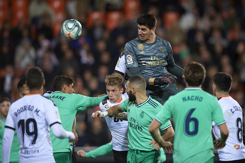 VALENCIA, SPAIN - DECEMBER 15: Thibaut Courtois (C) of Real Madrid in action during the Liga match between Valencia CF and Real Madrid CF at Estadio Mestalla on December 15, 2019 in Valencia, Spain. (Photo by Pablo Morano/MB Media/Getty Images)