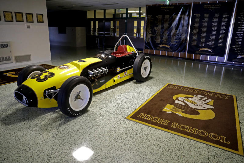 A Roadster is parked inside of the main entrance of Speedway High School, Tuesday, April 21, 2020, in Indianapolis. Racing is on hold with the Indianapolis Motor Speedway closed due to the coronavirus pandemic. (AP Photo/Darron Cummings)