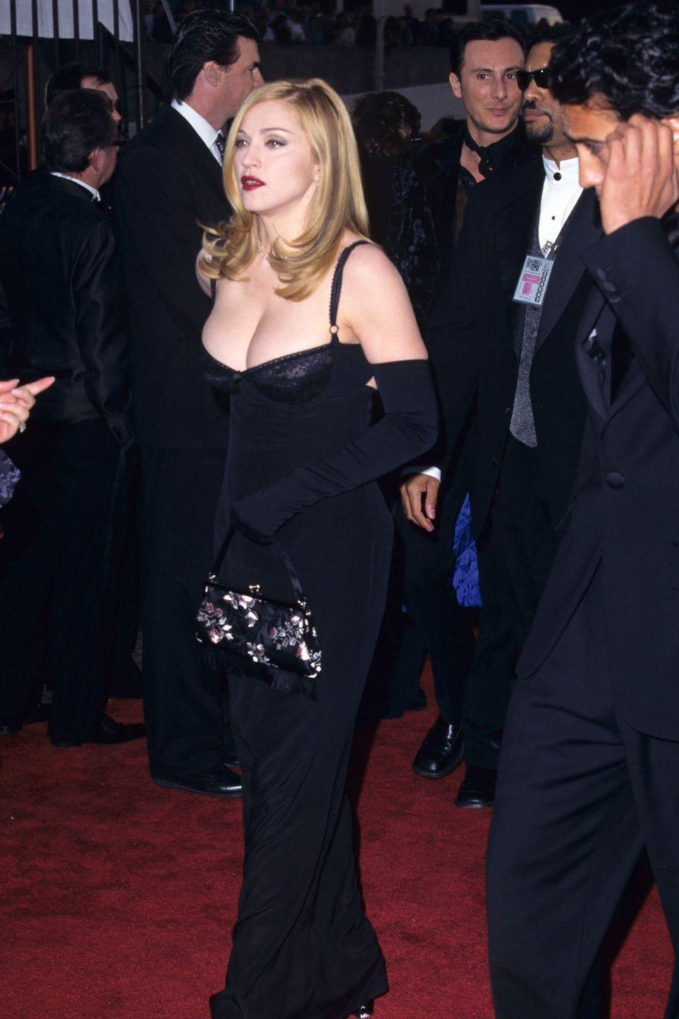 <p>Always known for risqué style, the queen of pop kept it classic in 1997 albeit with ample cleavage. </p>