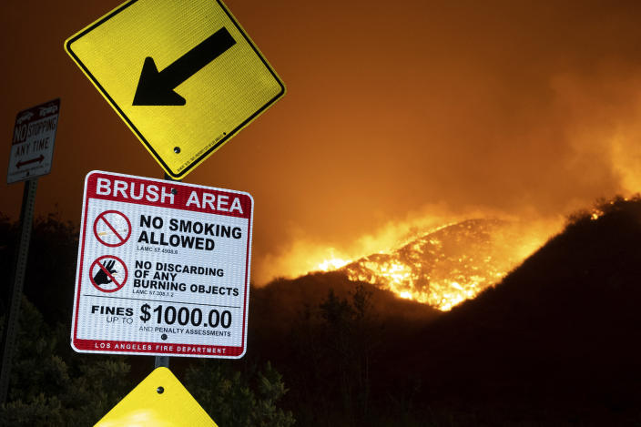 Flames from a wildfire burn along the hills north of Sesnon Boulevard, Friday morning, Oct. 11, 2019, in Porter Ranch, Calif. (Photo: David Crane/The Orange County Register via AP)