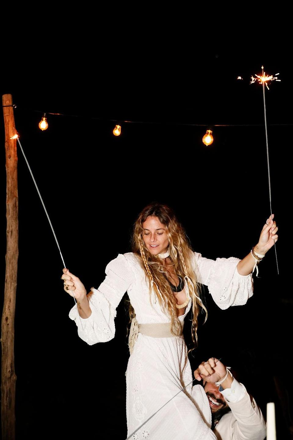 """""""Christina Coniglio and husband Adam Silverstein, dance with sparklers in hand,"""" Nicholas says. """"Taking in the magic and fun."""""""