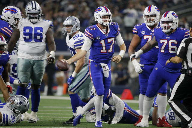Buffalo Bills quarterback Josh Allen (17) celebrates after recovering a fumbled snap and getting a first down on the play in the first half of an NFL football game against the Dallas Cowboys in Arlington, Texas, Thursday, Nov. 28, 2019. The Cowboys' Maliek Collins (96) and Bills Jon Feliciano (76) look on during the play. (AP Photo/Michael Ainsworth)