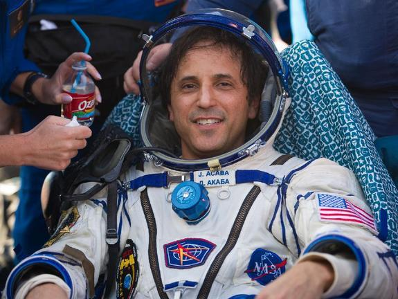 Astronaut Joe Acaba is seen as he rests outside the Soyuz TMA-04M capsule just minutes after he and two crewmates landed in a remote area outside of the town of Arkalyk, Kazakhstan, on Sept. 17, 2012.