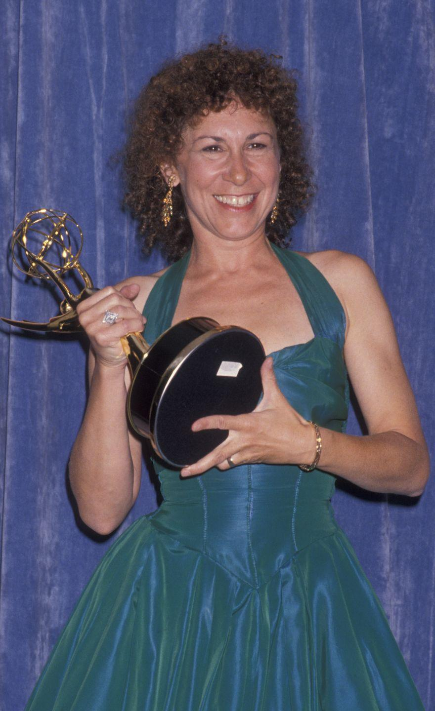 <p>Wearing a two-toned turquoise dress, the comedic powerhouse took home her fourth Emmy. </p>