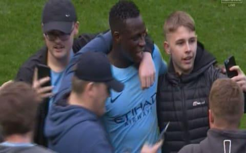 "It was not just the sight of Manchester City running up another avalanche of goals and playing football from another planet that will have disheartened their immediate rivals here. With 15 minutes still to go in the latest exhilarating demonstration of show-stopping football that had swept Pep Guardiola's team to the title with five games to go, Benjamin Mendy returned to the pitch almost seven months to the day since rupturing his cruciate ligament injury. A season in which City still threaten to break all manner of records has been played largely without the most expensive full-back in the game and the sight of the France defender returning to the fray merely underlined the challenge the rest of the Premier League will have trying to rein this team in next season. They have yet to spend again, which they will do, and already they are stronger. City need just two wins from their final four league games to break Chelsea's record Premier League points haul of 95. Six more goals and they will also eclipse the record 103 goals Chelsea scored in 2009/10. By the end of an intoxicating afternoon when Swansea City became a punchbag, the Manchester City supporters could not contain themselves. David Silva and Raheem Sterling scored City's first two goals Credit: Getty images Flooding the field at the final whistle, they mobbed their triumphant players, blissfully ignoring subsequent calls to vacate the pitch as they stood in their hundreds in front of the tunnel cheering and chanting. It was quite the scene although it is still likely to invite a charge from the Football Association, not least when you consider that Wigan Athletic were charged after their fans invaded the pitch following February's FA Cup win over Manchester City. ""We have become champions with five games left but that doesn't mean we can now stop and put our feet up,"" Guardiola said in his programme notes. Not when there are records to break. Not when Manchester City still have a big say in what happens at the opposite end of the table. Not when a carnival atmosphere demanded more carnival football which, unsurprisingly, they duly delivered, their opponents left dazed and confused on the passing carousel. Successful passes in the first half Swansea City's top flight status was not going to be determined by what happened here and, for all the wonders Carlos Carvalhal has worked since taking charge of the club in December, he will have known it was going to take something very special to rain on the host's parade. Within 16 minutes, though, it had simply become a case of damage limitation. Survival is firmly in Swansea City's hands but it is not unfeasible goal difference could still have a bearing on who stays up and hoping Guardiola's side did not run up a cricket score will have been uppermost in the Carvalhal's mind once Raheem Sterling scored his team's second goal four minutes after he had helped fashion the opener for David Silva. By the end, he will probably have been relieved to keep it to five such was the chasm in quality. The first two goals were what everyone would now characterise as classic Manchester City team goals – you know the sort by now: the blur of passes, the stealth like movement, the calm close range finish. The first was beautifully orchestrated – Sterling to Fabian Delph to Aymeric Laporte to De Bruyne who, spotting Sterling making a dart to the byline, stroked a sublime pass with the outside of his right boot in behind Kyle Naughton. Man City 3 - 0 Swansea (Kevin De Bruyne, 54 min) Sterling had the presence of mind to pull the ball back from Silva – how his final ball has improved – and the Spaniard did the rest, holding off a stretching Mike van der Hoorn to volley home. In doing so, he became the sixth Manchester City player this season to reach double figures in all competitions. Poor Naughton. It was mayhem on his side and, before long, he was being picked on again, this time Silva cushioning a beautifully weighted pass in behind the Swansea City wing back for Delph to latch on to and square a pass for Sterling to tap home for his 23rd goal of the campaign. De Bruyne fires home from distance Credit: Reuters They punish you mercilessly, Silva and De Bruyne, with the unerring accuracy of their passing. It required a double take initially but Manchester City completed an astonishing 542 passes in the first half. To put that into context, five of Guardiola's players completed more passes individually in the opening 45 minutes than the entire Swansea City team. It was that one-sided. Alfie Mawson managed a speculative shot on target for the visitors in the 44th minute but that was as good as it got for them. If the team goal does not do for beleaguered opponents, though, there's always the moment of individual brilliance to leave them utterly deflated. Step forward De Bruyne. Tom Carroll played an ambitious pass out to Jordan Ayew that might have had a chance had the Swansea City striker not been dozing. Laporte nipped in front and prodded the ball to De Bruyne who, surveyed the scene, spotted a clearing and then launched a blistering 30-yard drive into the far corner as the Etihad rose to acclaim its beloved Belgian. Possession: Man City vs Swansea There was plenty more for the natives to gorge over. Local boy Phil Foden produced a tantalising cameo, weaving past three bodies before sticking a cross on Gabriel Jesus's head that the Brazilian seemed certain to dispatch only to head straight at Lukasz Fabianski. Jesus had already missed a penalty by then when Federico Fernandez scythed through Sterling only for his blushes to be spared when Bernardo Silva tucked home the rebound. It did not look like being Jesus's afternoon but then Yaya Toure floated a fine pass over Swansea City's ramshackle defence and this time the striker made no mistake with a smartly controlled header. Man City vs Swansea shots on goal 6:22PM Full time City win 5-0. They are just too good to be playing teams like Swansea on a weekly basis. Fans stream onto the pitch to celebrate and every one of the City players look terrified, except Benjamin Mendy, who is absolutely loving it. Kompany is escorted off the pitch 6:18PM 90 mins +1 Gundogan nearly gets in on the act but puts his first time effort over the bar. 6:17PM 90 mins Two minutes added on. No Swansea player wants to play these final two minutes. 6:16PM GOOOOAL! Jesus has his goal! If you give Toure time to pick a pass 40 yards from goal he does it as well as anyone on the planet. Jesus runs off the final defender to meet Yaya's chipped through ball and he heads into the far corner to make it 5-0. Unstoppable. Man City 5 - 0 Swansea (Gabriel Jesus, 88 min) 6:15PM 87 mins Everyone wants a goal! Kompany is hanging on the shoulder of the last defender, and runs onto a dinked Yaya Toure through ball like a seasoned centre-forward. He doesn't quite take it down in hit path properly, and it bounces up before he heads just wide. 6:11PM 83 mins Lovely from Foden, who jinks past three Swansea players out on the left and hangs a cross up into the six-yard box, and perfectly onto the head of Jesus, but his effort is straight at the keeper. Keeper pick-up: Man City 4 - 0 Swansea (Lukasz Fabianski, 83 min) 6:09PM 82 mins A patient passing move eventually finds its way to Mendy, but he mis-hits his shot which bounces harmlessly into Fabianki's arms. 6:06PM 79 mins Foden whisks past a challenge in midfield and is scythed down by Van der Hoorn. The referee blows for a free-kick but the ball had fallen to Silva, who swiftly slipped Sterling in on goal. That should have been advantage played, but the whistle went too quickly. Yaya Toure fires the free kick into the wall, and Swansea race up the other end with Abraham making good ground. He lifts a cross up to the back post, and the arriving Sam Clucas skews his volley horribly wide. Poor. 6:03PM 76 mins Given the experience English football has of Mendy - that of the joker he plays on social media - it's a little unusual to see him taking things so seriously or, well, without a smile on his face, out there. 6:02PM One of the biggest cheers of the afternoon... ...and it greets Benjamin Mendy's return to action. He replaces Delph at left-back. Tammy Abraham comes on for Martin Olsson for Swansea. 6:00PM Another City sub Foden replaces Sterling. 5:57PM 69 mins A whipped cross into the Swansea box is flicked on by Mawson, and rebounds off the inside of the post and down to a black shirt to be cleared. It remains four-nil, for now. 5:54PM Substitutions for each side De Bruyne given a standing ovation as he is replaced by Yaya Toure. Sam Clucas and Kyle Bartley replace Ki Sung-yueng and Federico Fernandez. 5:51PM GOOOOALL!! 4-0 to City. Gabriel Jesus nonchalantly wanders up to the spot, Fabianksi guesses right and saves the spot kick, pushing onto the post! But he's so so unlucky, with the rebounding coming out across goal and straight into the path of Bernardo Silva, who's first to react. Man City 4 - 0 Swansea (Bernardo Silva, 64 min) 5:49PM PENALTY MAN CITY! Silva slips Sterling in, he toes the ball past Fernandez and draws the foul. Craig Pawson points to the spot. Jesus to take. 5:45PM Player of the season? He gets my vote. 5 - Kevin De Bruyne has now scored five goals from outside the box in the Premier League this season; the most of any player. Smash. pic.twitter.com/17kNulRJFe— OptaJoe (@OptaJoe) April 22, 2018 5:44PM 57 mins Swansea win a corner and Ki's corner is met by Mawson, unchallenged, in the six-yard box... but he heads over the bar. A rare Swansea chance, and a wasted one. Miss: Man City 3 - 0 Swansea (Alfie Mawson, 56 min) 5:42PM WHAT A GOAL!!!! De Bruyne makes it 3-0! What a stunning strike that is! City pass, pass, pass, taking their time, but then Swansea get a foot in but only manage to half clear their lines. De Bruyne decides passing any more isn't worth it, and absolutely spanks one from 25 yards and out to the right. He connects with it so perfectly and it rockets into the left side of the goal with Fabianski left helpless. Man City 3 - 0 Swansea (Kevin De Bruyne, 54 min) 5:38PM 51 mins Swansea are doing a better job of breaking up play with little fouls and tackles, and City's fluency has thus been disrupted a little so far this half. Little action of note to report. De Bruyne shoots into the side netting from a tight angle. 5:33PM 46 mins Danilo whips a great cross across the face of the Swansea goal but no one is there to tap home. 5:32PM 45 minutes to go Is this just a case of damage limitation for Swansea, then? Probably. Can they keep the deficit to two goals? Probably not. The second half is under way. 5:18PM Half time It's been, just like so many other matches for Manchester City this season, oh, so easy. They are simply a cut above every other team in this league and have been all season. The difference between them and the teams fighting relegation is frightening, and Swansea simply don't have a chance. City are 2-0 up and there's no way back into this one for the Swans. Man City vs Swansea shots on goal 5:15PM 45 mins One minute added on. 5:15PM 45 mins Swansea have their first shot on target, and it comes from a run from deep from an unlikely source in Alfie Mawson. Ultimately it's an easy save for Ederson, but still something to cheer for the travelling fans. Attempt Saved: Man City 2 - 0 Swansea (Alfie Mawson, 45 min) 5:12PM 42 mins Anyone got any idea how Swansea get back into this one? Carlos Carvalhal watches from the touchline Credit: AFP 5:11PM 40 mins Swansea looks like they might have a chance to get at the City goal after De Bruyne charges out to intercept a long ball and misses it. Olsson controls and drives at Danilo, drops his shoulder and then takes it around him on the outside. His touch is poor, though, and he knows it, throwing himself to the ground in a desperate attempt to con the referee. Craig Pawson isn't moved, and gives Olsson a yellow for simulation. Good decision. 5:06PM 35 mins Jordan Ayew wants a free-kick in the centre circle but it's adjudged a good tackle by Delph, and he sets Jesus on his way down the right. The Brazilian drills a low effort at goal but Fabianski is equal to it. 5:03PM 33 mins Good save from Fabianski to keep De Bruyne's low effort from the edge of the box. The rebound falls to Sterling, but he is correctly flagged offside. Fabianski saved his effort, anyway. 5:01PM 30 mins Swansea are finally growing into the game a little, but chances are still way beyond them. 4:57PM Incredible stuff David Silva the 6th City player into double figures for the season now. That was his 10th of the campaign in all comps. Others: Aguero 30, Sterling 23, including one here v Swansea, Jesus 14, Sane 13, De Bruyne 11 #MCFC— James Ducker (@TelegraphDucker) April 22, 2018 4:54PM 25 mins It hits the wall, and City scramble it clear. 4:54PM 24 mins Sterling is adjudged to have pulled back King after City clear, and Swansea have a free-kick in a decent position. Olsson is over it, 25 yards from goal, right of centre. 4:53PM 22 mins Delph tries the most audacious of first time volleys, hitting Sterling's ball out to him back across goal, but it flies wide of the post. 4:51PM 20 mins Swansea haven't even got close to touching the ball within 30 yards of the City goal, and it has just been one way traffic so far. Carvalhal said Swansea had a plan to stop City, but there is no way back from this now. It's just a question of how many City get. Man City vs Swansea 4:47PM GOOOOOAAAAAL! Sterling makes it 2-0! Delph stands Naughton up, plays a swift one-two with Silva, and drills low across goal where a grateful Raheem Sterling is waiting to tap home his 18th league goal of the season. Man City 2 - 0 Swansea (Raheem Sterling, 16 min) 4:46PM 14 mins Celebrations galore at the Etihad: Credit: afp Credit: AFP 4:45PM GOOOOOOOAAAAALL!!! David Silva puts City 1-0 up Just like that (see last post) Silva is in fact on the end of a move, after De Bruyne picks Sterling out with a lovely ball with the outside of his boot around the defender on the City left. Sterling runs onto it, and cuts back to Silva, who takes one touch before thrashing home from an angle. 1-0 City and it's just so easy for them. Man City 1 - 0 Swansea (David Silva, 12 min) 4:41PM 10 mins Silva is running things in midfield, seeing plenty of the ball between the lines, and it surely won't be long until he picks out a killer final ball. Swansea already making a few desperate challenges to stay level. 4:38PM 6 mins Olsson just took the worst cross I have ever seen. It went at about 90 degrees away from the direction he'd intended. Real Sunday League stuff. Truly beautiful. 4:33PM 3 mins ""Stand up for the champions"" is being sung in the Etihad stands. Haven't yet heard anyone sing 'if you're happy and you know it'. Yet City settling into plenty of early possession. Swansea are working very hard indeed. This could be a long afternoon. 4:30PM Off we go Thanks for the Guard of Honour and the warm reception @SwansOfficial and fans. Here's to a great game! �� #cityvswans#mancity— Manchester City (@ManCity) April 22, 2018 Let's get on with the footy! City get things started. 4:27PM The celebrations We've just had a guard of honour for the champions. Swansea's players clap City's onto the pitch 4:19PM Swansea's warm-up Sky have just shown a clip of Swansea's back five warming up by moving in a line back and forth, side to side, in perfect co-ordination. They'll have to play like that to for 90 minutes to get anything from today's game. 4:16PM Carlos Carvalhal talks ""I understand the past: City have only lost one game at home, usually scoring three, four, five goals. They are champions, they are the best team and one of the best in Europe. ""We know about all of this. From our side, we have a strategy to try and stop them, it won't be easy because they are so strong, but we also have a strategy to try and play and our football and score goals. ""We will do our best to try and achieve something. Let's play!"" 4:07PM They've let the fans get hold of the trophy outside the ground Credit: Reuters Credit: getty images (I think it's probably a replica trophy.) 3:59PM At the other end of the table After Stoke's draw with Burnley, Swansea remain four points clear of safety with one game in hand over Southampton and two over Stoke. They have every chance of survival, but they will still want to try and get something from today's game. Away to the champions, though, they will be up against it. 3:38PM It's good to have him back it's been a long run, but the Shark is finally back on track �� @ManCitypic.twitter.com/Kd7Xc1LF68— Benjamin Mendy (@benmendy23) April 22, 2018 3:35PM Swansea team �� Today's team news from the Etihad Stadium...#MCISWApic.twitter.com/trz3dI8KfV— Swansea City AFC (@SwansOfficial) 22 April 2018 3:35PM Benjamin Mendy returns to the squad Your Champions line-up like this! �� City XI: Ederson, Danilo, Kompany (C), Laporte, Delph, Gündogan, De Bruyne, Bernardo, Silva, Sterling, Jesus Subs: Bravo, Walker, Sané, Mendy, Otamendi, Touré, Foden Presented by @HAYSWorldwidepic.twitter.com/W6TduoN1X5— Manchester City (@ManCity) 22 April 2018 3:34PM Stand up for the champions The banners are ready and the champagne on ice for Manchester City, who are having at party at the Etihad Stadium against Swansea City. City's season did seem to be winding down to an anti-climactic finish after defeats in the Manchester Derby and the Champions League quarter-final against Liverpool. A comprehensive performance and victory over Spurs was a worth exclamation point at the end of their league campaign however, and they were confirmed as champions when West Brom won at Man Utd. Team news to follow..."
