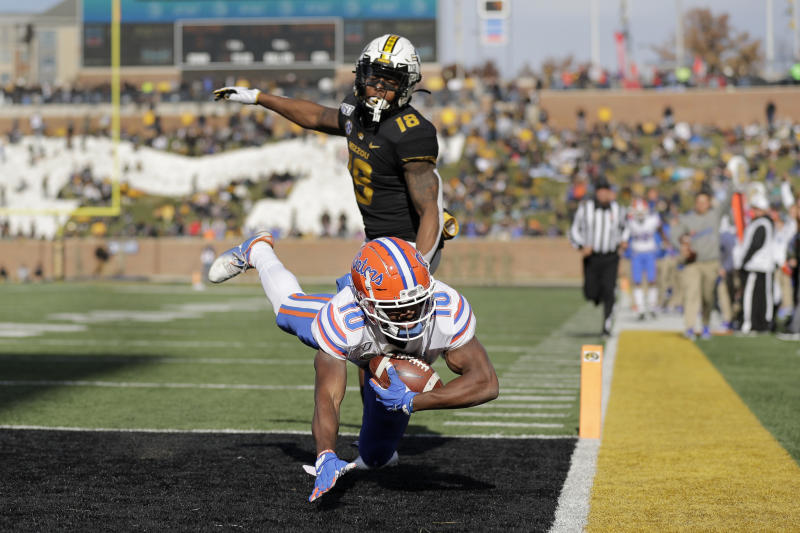 Florida wide receiver Josh Hammond (10) dives into the end zone after catching a touchdown pass as Missouri safety Joshuah Bledsoe (18) defends during the second half of an NCAA college football game Saturday, Nov. 16, 2019, in Columbia, Mo. Florida won 23-6. (AP Photo/Jeff Roberson)