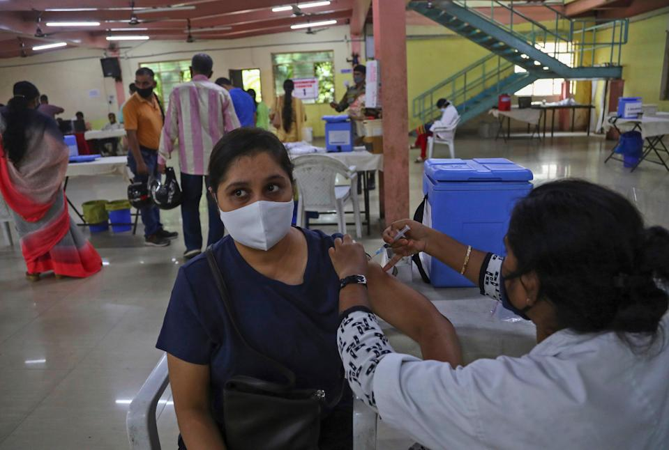A health worker administers the Covishield vaccine to a woman in India's Hyderabad on 23 June, 2021 (AP)