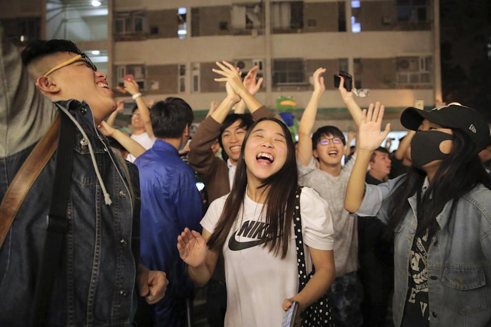 Opposition supporters celebrate a win in the 2019 district council elections. Photo: AP