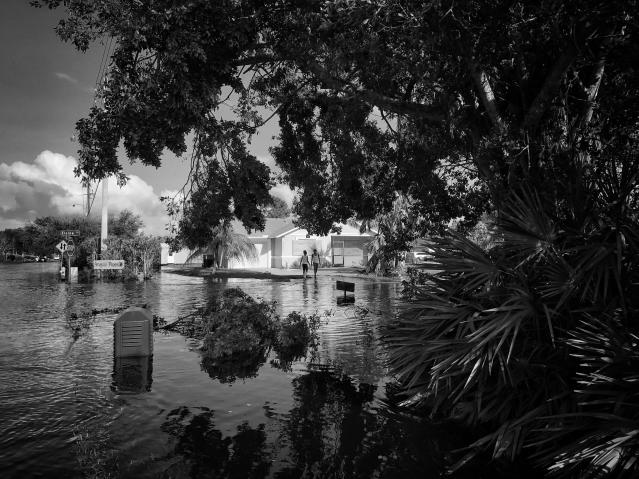 <p>Kids stand along the edge of a flooded street in the aftermath of Hurricane Irma in Bonita Springs, Fla. (Photo: Holly Bailey/Yahoo News) </p>