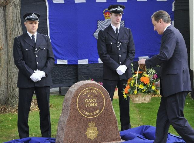 David Cameron lays a wreath during a memorial ceremony for Gary Toms