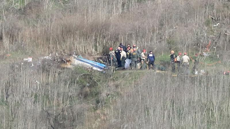 Emergency personnel, pictured here working at the helicopter crash site that claimed the life of Kobe Bryant.
