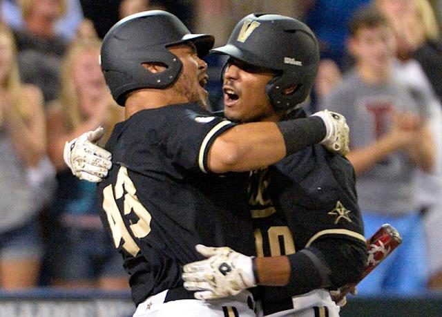 Vanderbilt's John Norwood, right, celebrates with Zander Wiel after hitting a home run against Virginia in the eighth inning of Game 3 of the best-of-three NCAA baseball College World Series finals in Omaha, Neb., Wednesday, June 25, 2014. (AP Photo/Ted Kirk)