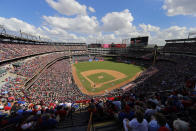Fans watch as the New York Yankees play the Texas Rangers in the fifth inning of a baseball game at Globe Life Park in Arlington, Texas, Sunday, Sept. 29, 2019. The game was the final contest for the Rangers of the 2019 season, and the final game at the park for them. The club will play in a new stadium, Globe Life Field, still under construction across the street from the park, in the 2020 season. (AP Photo/Tony Gutierrez)