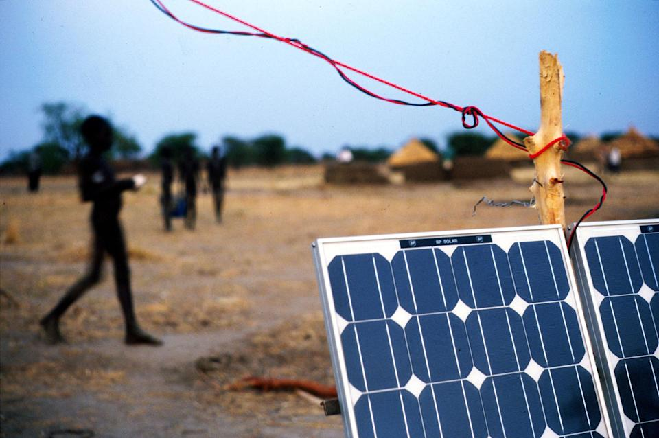 364091 26: Solar panels and wiring provide power amplification and lighting to a meeting hall for a peace conference between the Dinka and Neur tribes March, 1999 in Wunlit, Sudan. Photo by Malcolm Linton