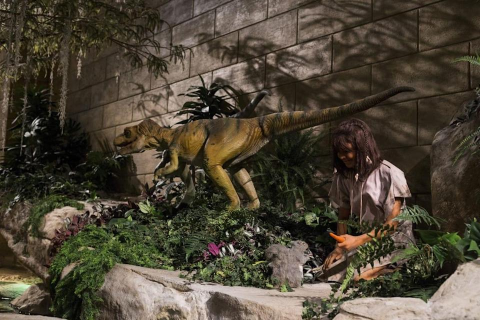 """<div class=""""inline-image__caption""""> <p>A stone-age woman sits next to a dinosaur in the front lobby at the Creation Museum—even though there is no scientific evidence the two co-existed.</p> </div> <div class=""""inline-image__credit""""> Brittany Greeson/Reuters </div>"""