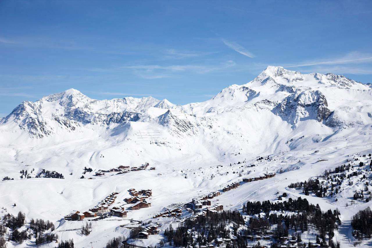 """<p>One of Switzerland's oldest tourist destinations, Champéry began welcoming out-of-towners in the early 1850s. And with its location—between the Dents-du-Midi peaks and the Dents Blanches, in the Lower Valais—it persists as a base for modern-day plankers who come to ski their way around the massive <a href=""""http://en.portesdusoleil.com/"""" target=""""_blank"""">Les Portes du Soleil</a> ski area, which comprises 12 resorts on both sides of the France-Switzerland border. From Champéry, the most seasoned of skiers can access the famed """"Le Mur Suisse,"""" or The Swiss Wall. It's one of the steepest and most difficult tracks in the world, with a near-vertical slope.</p> <p><strong>Stats:</strong> For roughly $54, a single adult <a href=""""https://www.skipass-pds-ch.ch/en/Tarifs/hiver-2019-20"""" target=""""_blank"""">day pass</a> grants access to the area's four Swiss resorts—Champéry, Les Crosets, Champoussin, and Morgins—and their combined 37 lifts.</p> <p><strong>Where to eat and drink nearby:</strong> Overlooking the Dents-du-Midi, <a href=""""http://www.restaurantle42.ch/"""" target=""""_blank"""">Le 42</a> strikes a just-right balance of cozy and refined thanks to its timber interiors, crackling fireplace, and modern, French-inspired fare. Prefer to refuel with some gooey raclette? The chalet-style <a href=""""http://www.lesrives.ch/"""" target=""""_blank"""">Cantine des Rives</a> has been melting it over a wood fire since 1949.</p> <p><strong>Where to stay:</strong> What Champéry lacks in ski-in/ski-out options—a cable car and chair lift in the village center carry skiers to surrounding slopes—it makes up for with charming hotels in the center of town, like <a href=""""http://www.lenational.ch/en/"""" target=""""_blank"""">Hotel National Resort & Spa</a>.</p>"""