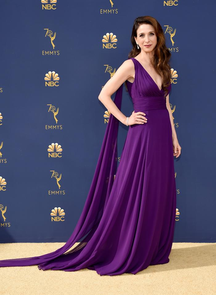 """<p>You would never guess that this was fashion stylist Micah Schifman's first time working with <em><a rel=""""nofollow"""" href=""""https://www.townandcountrymag.com/leisure/arts-and-culture/a16723931/the-marvelous-mrs-maisel-season-2/"""">Marvelous Mrs. Maisel</a></em> star Marin Hinkle: their energy makes it seem like they've known each other forever. Schifman, who's worked with A-list celebrities like Diane Kruger and Sarah Silverman, shared that the month-and-a-half long process of creating Hinkle's Emmy Awards look resulted in exactly what the two had envisioned from day one - every stylist's dream come true.</p><p>Hinkle stepped out onto the 2018 Emmy Awards golden carpet wearing a vibrant custom-made violet dress. The tulle and chiffon gown was designed by Oliver Tolentino, a local Los Angeles talent that Hinkle found. Dramatic <a rel=""""nofollow"""" href=""""https://www.normansilverman.com/"""">Norman Silverman</a> diamonds, strappy <a rel=""""nofollow"""" href=""""https://www.stuartweitzman.com/home/"""">Stuart Weitzman</a> heels, and an embellished <a rel=""""nofollow"""" href=""""https://www.swarovski.com/en-US/"""">Swarovski</a> clutch added the finishing touches to Hinkle's look. </p><p>Get a behind-the-scenes look at Schifman and Hinkle's process here:</p>"""