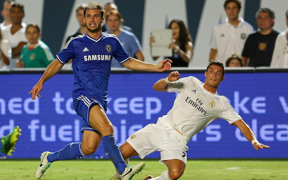 Cristiano Ronaldo and Branislav Ivanovic fight for the ball
