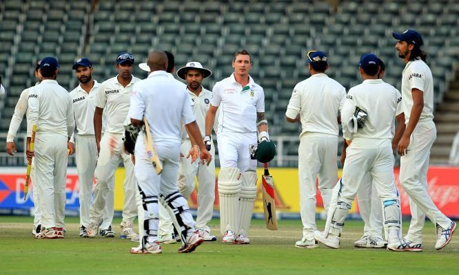 Indian and South African players shakes hand at the end of final day of the first test match between India and South Africa played at New Wanderers Stadium in Johannesburg on Dec.22, 2013. (Photo: IANS)