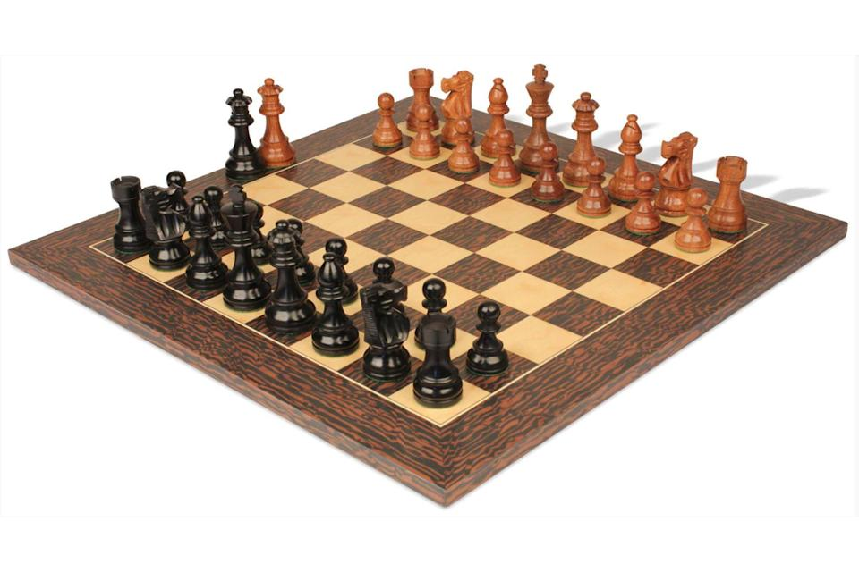 """<p><strong>The Chess Store</strong></p><p>thechessstore.com</p><p><strong>$259.00</strong></p><p><a href=""""https://go.redirectingat.com?id=74968X1596630&url=https%3A%2F%2Fthechessstore.com%2Ffrench-lardy-staunton-chess-set-ebonized-acacia-pieces-with-deluxe-tiger-ebony-chess-board-3-75-king%2F&sref=https%3A%2F%2Fwww.townandcountrymag.com%2Fstyle%2Fcollectibles%2Fg34763166%2Fbest-chess-sets%2F"""" rel=""""nofollow noopener"""" target=""""_blank"""" data-ylk=""""slk:Shop Now"""" class=""""link rapid-noclick-resp"""">Shop Now</a></p><p>This acacia and maple wood board takes you back to the basics. Perfect for the player who wants to focus on the game with quality. </p>"""