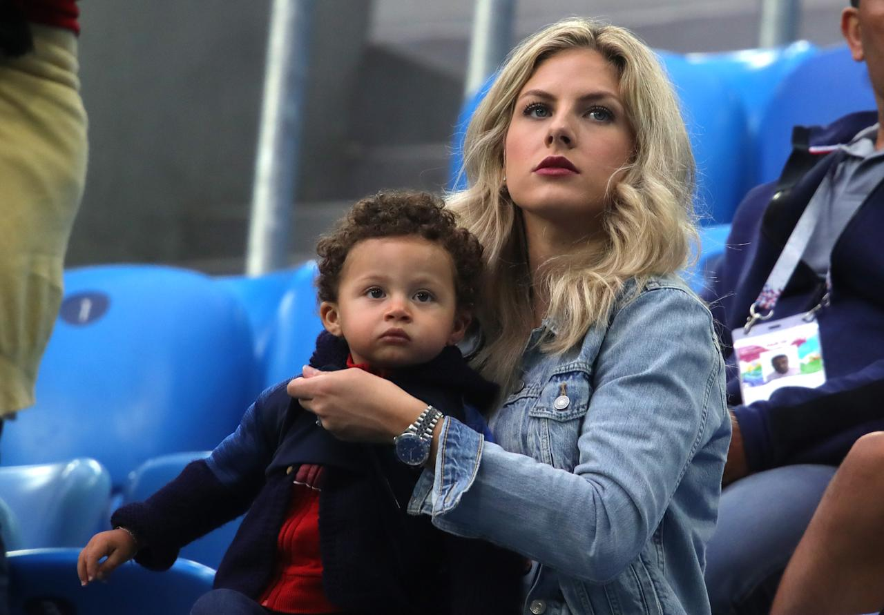 <p>Raphael Varane's wife Camille Tytgat and son Ruben attend the 2018 FIFA World Cup Russia Semi Final match between Belgium and France at Saint Petersburg Stadium on July 10, 2018 in Saint Petersburg, Russia. (Photo by Alexander Hassenstein/Getty Images) </p>