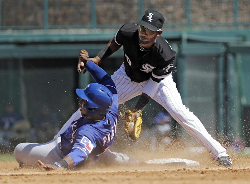 Chicago White Sox shortstop Alexei Ramirez, right, tags out Texas Rangers' Jurickson Profar, who was trying to steal second base in the third inning of a spring exhibition baseball game Tuesday, March 11, 2014, in Glendale, Ariz. (AP Photo/Mark Duncan)