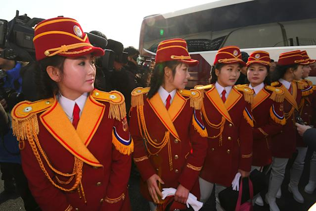 <p>North Korean cheerleaders arrive to participate in a welcoming ceremony for North Korea's Olympic team at the Olympic Village in Gangneung on February 8, 2018, ahead of the Pyeongchang 2018 Winter Olympic Games. </p>