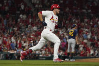 St. Louis Cardinals' Nolan Arenado, left, rounds the bases after hitting a solo home run off Milwaukee Brewers pitcher Hoby Milner (55) during the seventh inning of a baseball game Tuesday, Sept. 28, 2021, in St. Louis. (AP Photo/Jeff Roberson)