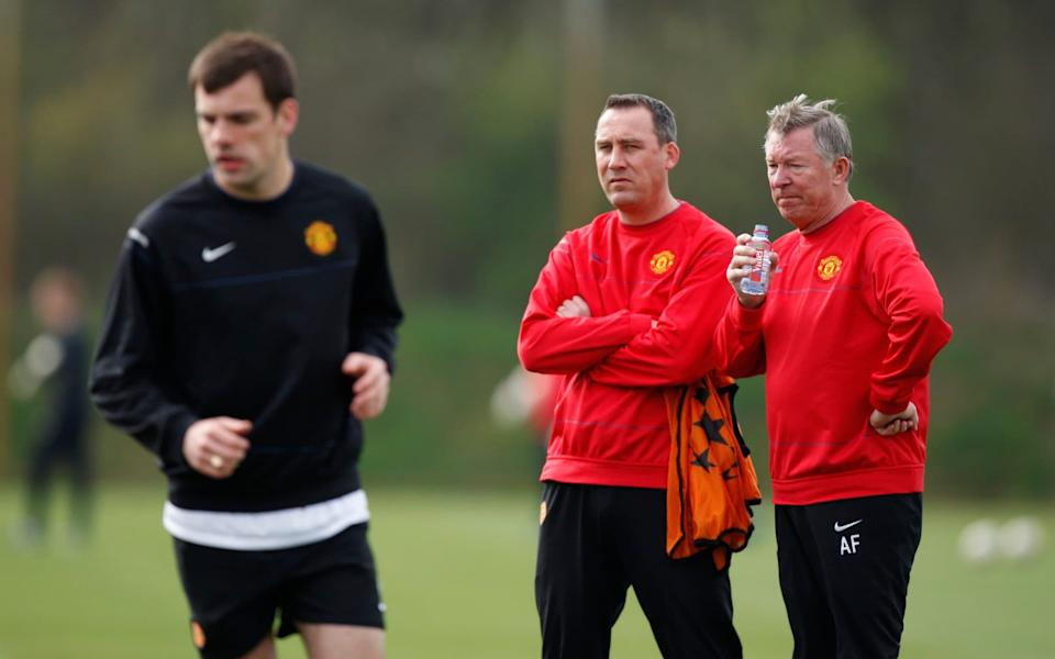 Manchester United's manager Sir Alex Ferguson, right, is seen alongside coach Rene Meulensteen during a training session at Carrington training ground the day before their Champions League quarterfinal first let soccer match against FC Porto, in Manchester, England, - AP