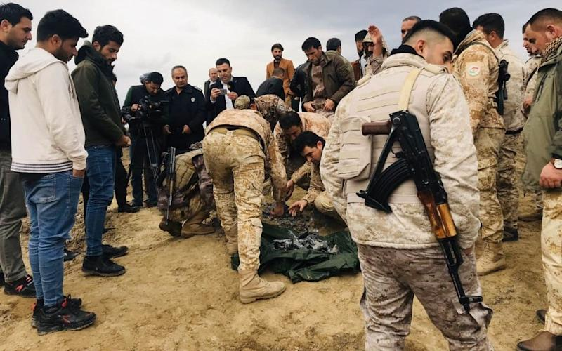Iraqi security forces find and collect the pieces of missiles as they gather to inspect the site after Iran's Islamic Revolutionary Guard Corps (IRGC) targeted Ain al-Asad airbase in Iraq, a facility jointly operated by U.S. and Iraqi forces, at Bardarash district of Erbil in Iraq - Anadolu