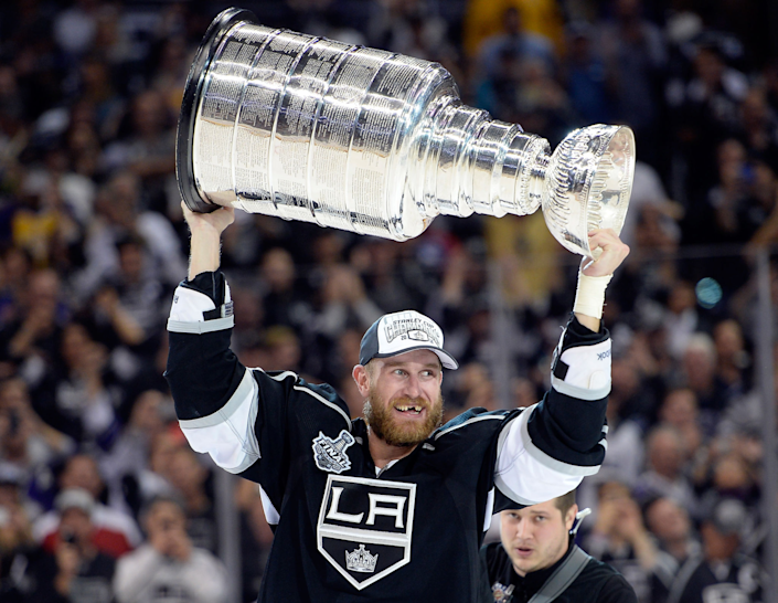 Jeff Carter carries the Stanley Cup after the Kings victory over the New York Rangers.