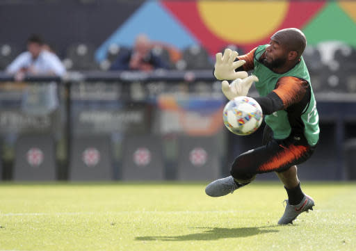 Netherlands goalkeeper Kenneth Vermeer makes a save during a training session at the D. Afonson Henriques stadium in Guimaraes, Portugal, Wednesday, June 5, 2019. The Netherlands will face England Thursday in a UEFA Nations League semifinal soccer match. (AP Photo/Luis Vieira)