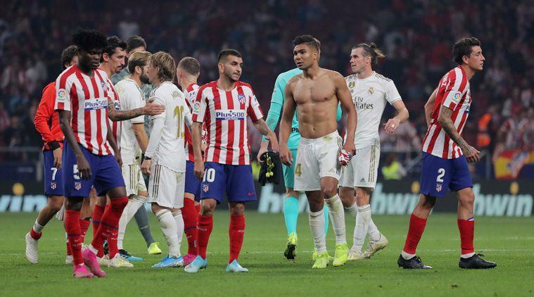 Real Madrid's Casemiro and Atletico Madrid's Angel Correa after the match. (Source: Reuters)