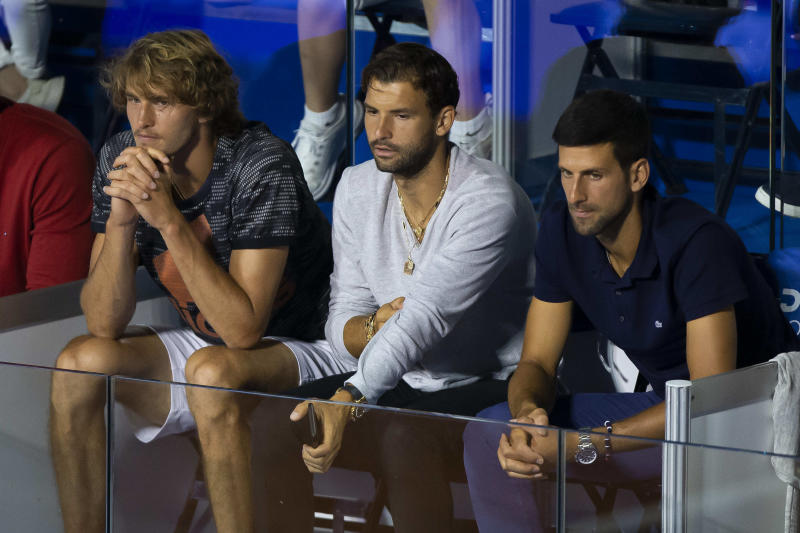 BELGRADE, SERBIA - JUNE 14: Alexander Zverev of Germany, Grigor Dimitrov of Bulgaria and Novak Djokovic of Serbia watch the final match between Dominic Thiem of Austria and Filip Krajinovic of Serbia on June 14, during the 3rd day of Summer Adria Tour, 2020 in Belgrade, Serbia. (Photo by Nikola Krstic/MB Media/Getty Images)